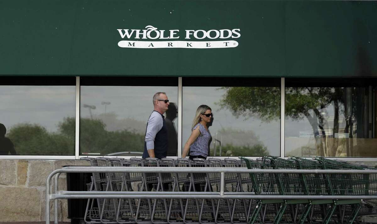 Shoppers enter a Whole Foods Market, Friday, June 16, 2017, in San Antonio. Amazon is buying Whole Foods, which has two San Antonio locations, in a deal valued at about $13.7 billion.