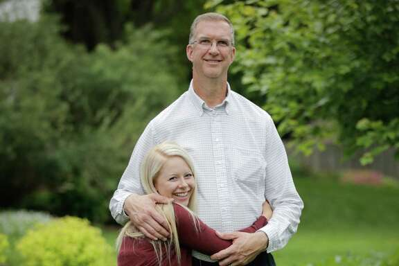 Lizzie Johnson and her father, who stands 6 feet 8 because of a connective tissue disorder that prevents his cells from correctly growing and developing.