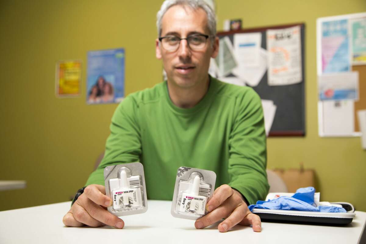 Jon Catzel, a Toronto social worker and metal health councillor for the Hepatitis C program at the Sherbourne Health Centre, shows a naloxone kit, which temporarily reduces the effects of opioid overdose.