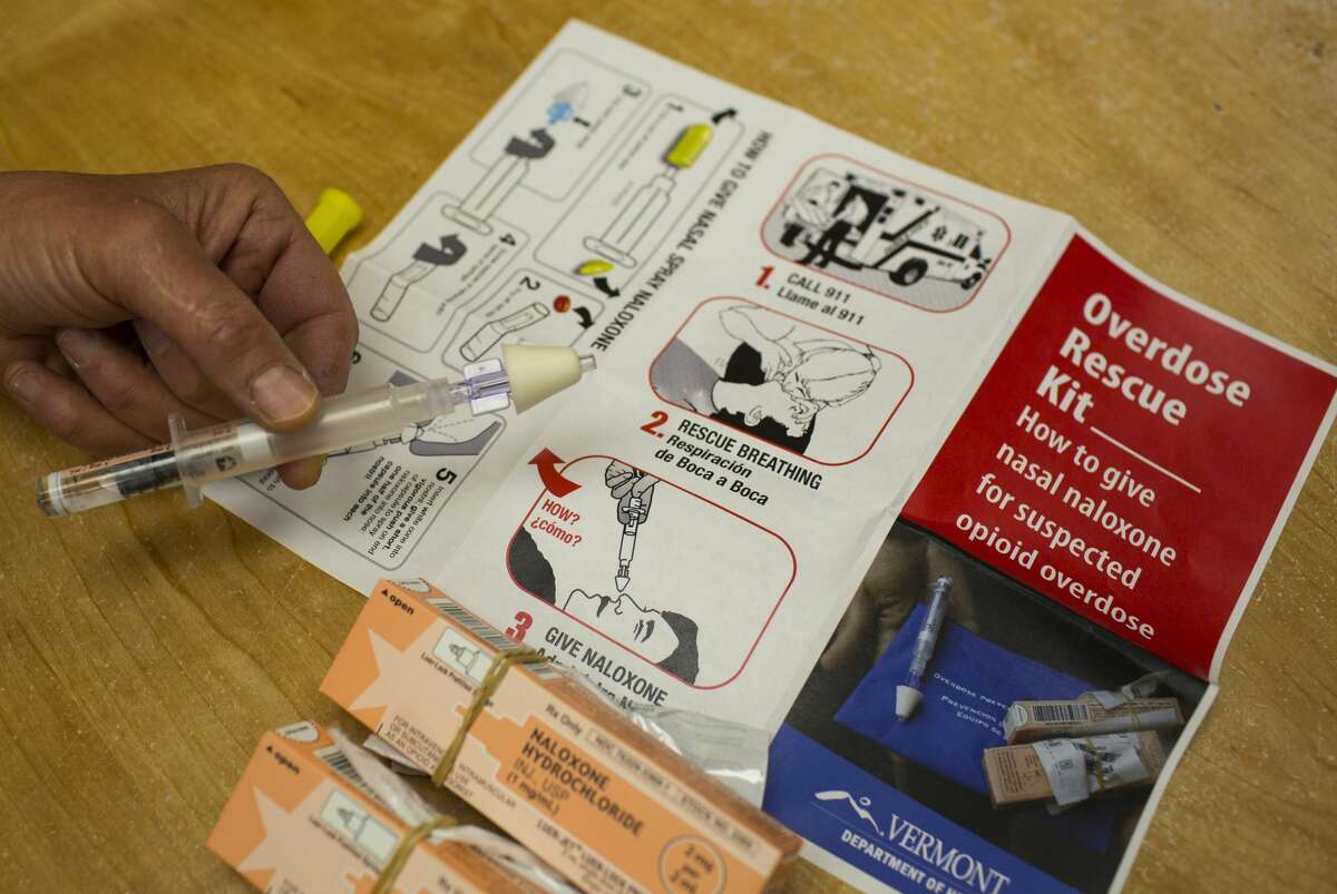 View of an 'Overdose Rescue Kit,' which includes naloxone, a syringe for nasal atomization, and instructions, as displayed at Howard Center, Burlington, Vermont, May 24, 2016.