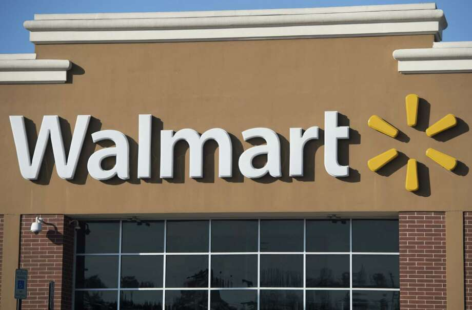 (FILES) This file photo taken on December 31, 2014 shows a Walmart store  in Landover, Maryland. Leading retailers that sell groceries, including Wal-Mart Stores, fell sharply on June 16, 2017, pressuring the broader market, following Amazon's announcement it will acquire Whole Foods Market.Amazon's deal to buy the upscale US grocery chain for $13.7 billion throttled the broader retail sector on concerns the online retail giant will create an even tougher environment for grocers. / AFP PHOTO / SAUL LOEBSAUL LOEB/AFP/Getty Images Photo: SAUL LOEB / AFP or licensors