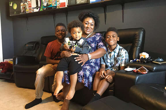 Jessica Chester, with her three children, Ivory, left, Kameron and Skylar,  got a degree and works for a Dallas hospital doing community outreach and family planning.