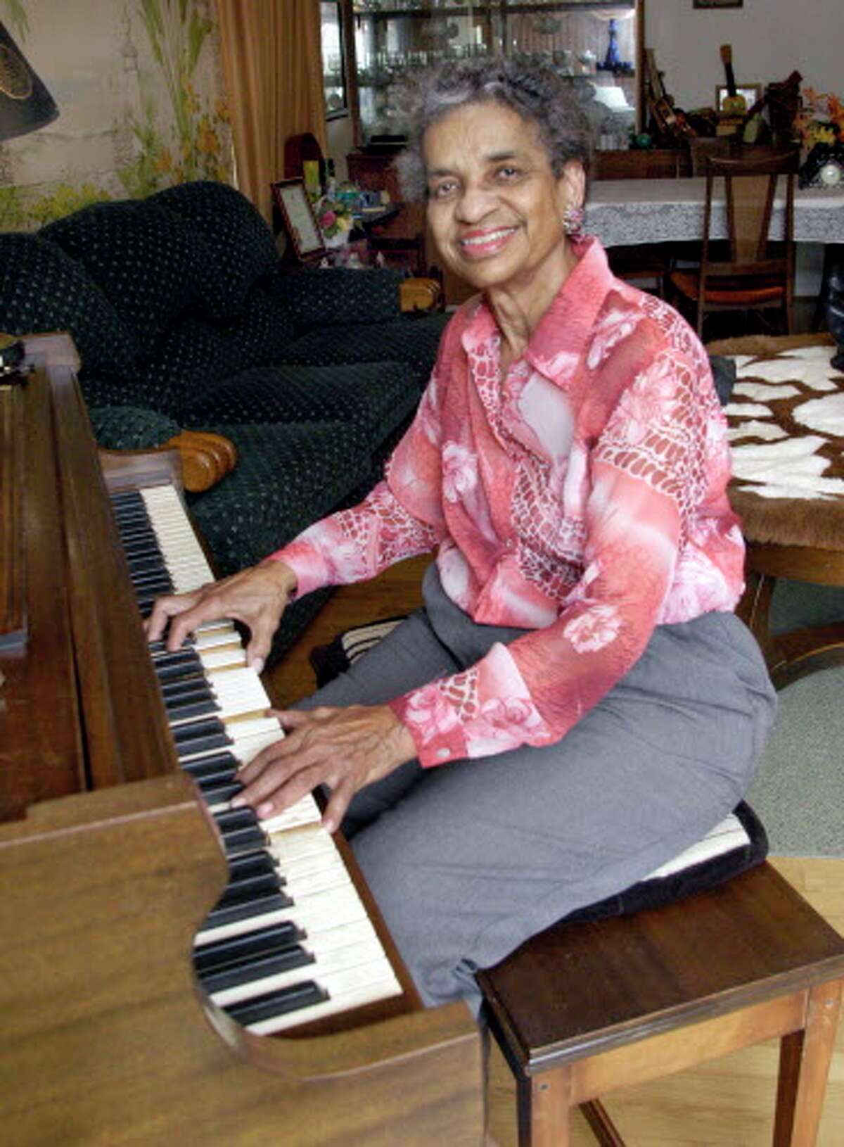 Izola Collins is shown playing piano at her home in Galveston. Collins, an educator, musician and author, was selected by the Galveston Historical Foundation as its 2006