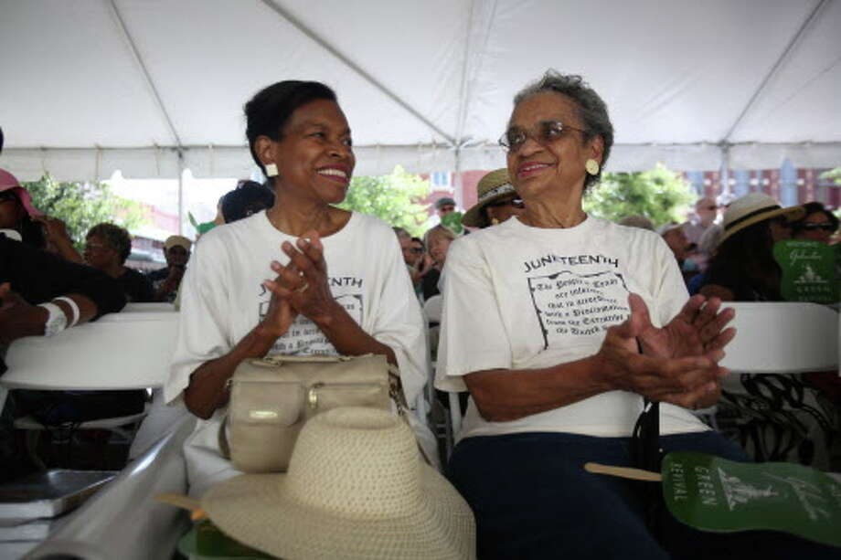 Diane Henderson and Izola Collins attend the Juneteenth Marker Dedication Ceremony hosted by Galveston Historical Foundation and Texas Historical Commission  on June 21, 2014, in Galveston. Ms. Collins died in June 2017 at age 87. Photo: Mayra Beltran, Houston Chronicle / © 2014 Houston Chronicle