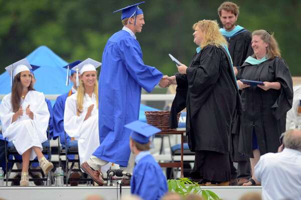 Finlay Collins receives his diploma from Principal Ellen Dunn during Darien High School Class of 2017 Commencement Exercises at the school in Darein, Conn., on Friday, June 16, 2017.