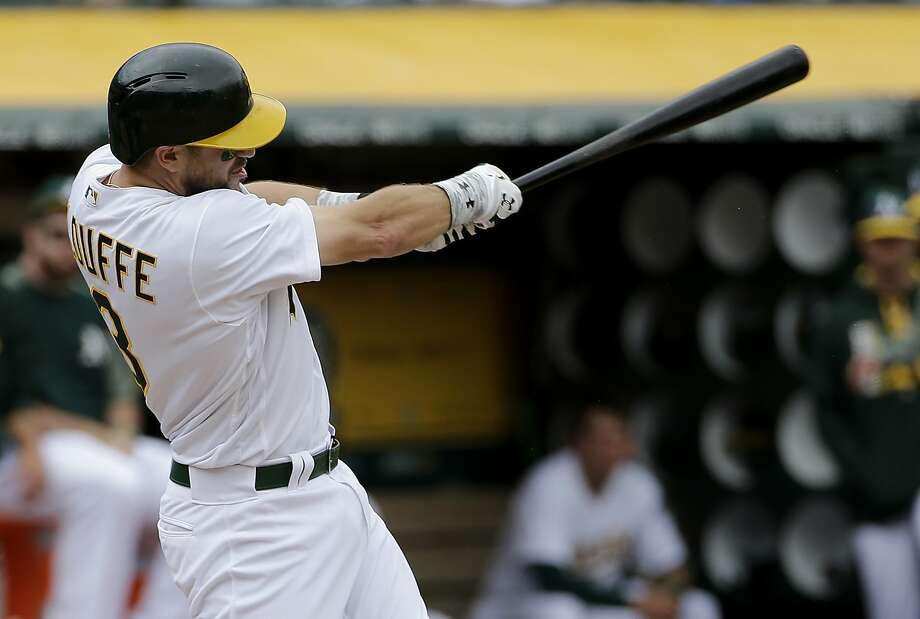 Oakland Athletics' Trevor Plouffe hits a solo home run against the Toronto Blue Jays during the fourth inning of a baseball game in Oakland, Calif., Wednesday, June 7, 2017. (AP Photo/Jeff Chiu) Photo: Jeff Chiu, Associated Press