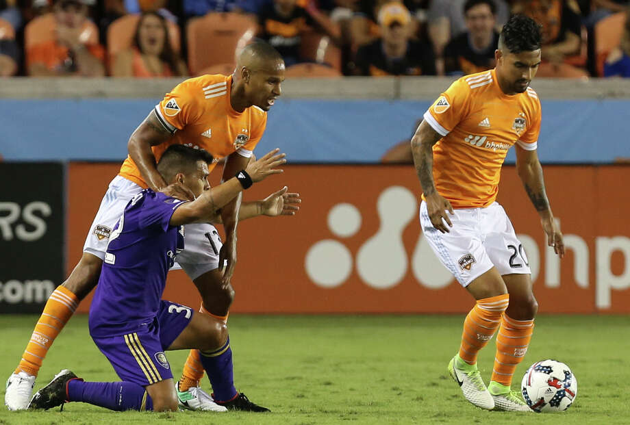 Dynamo defenders A.J. DeLaGarza, left, and Leonardo spent a combined 15 seasons with the Los Angeles Galaxy, playing in 289 games and winning three MLS Cups in the process. Photo: Yi-Chin Lee, Staff / © 2017  Houston Chronicle