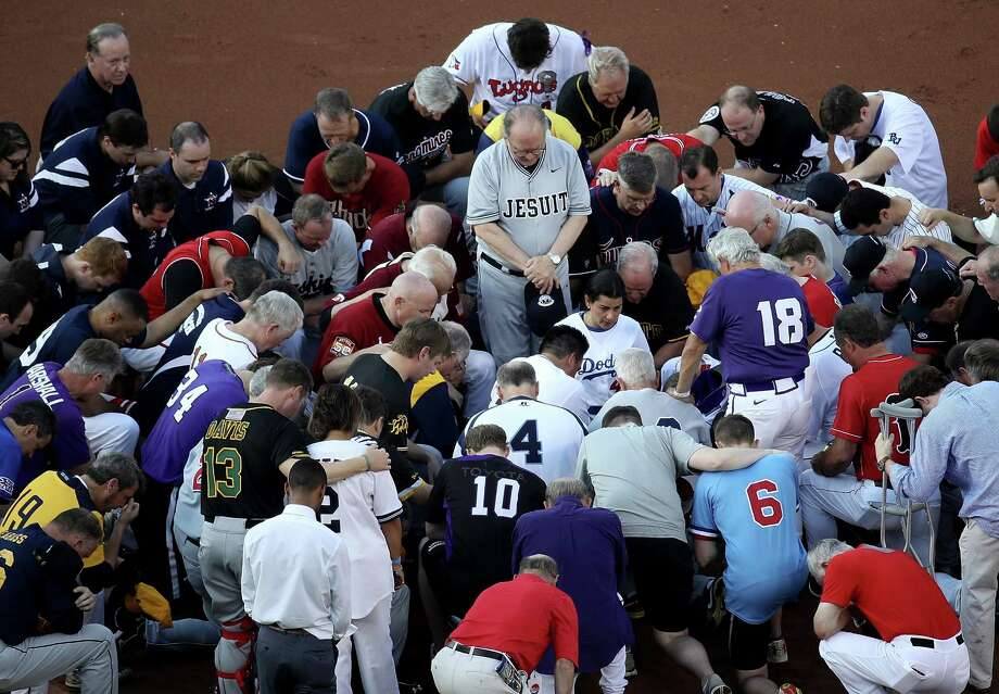 Members of the Republican and Democratic congressional baseball teams gather for a prayer Thursday before the annual game at Nationals Park.   (Photo by Win McNamee/Getty Images) Photo: Win McNamee, Staff / 2017 Getty Images