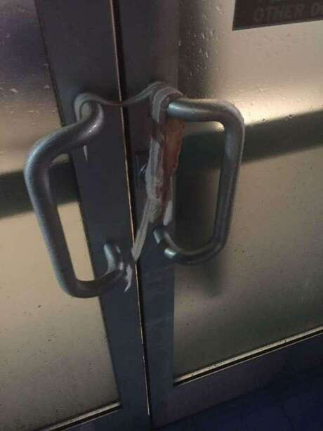 Bacon was wrapped around the door handle of the Islamic Center of Davis in January. Photo: Davis Police Department