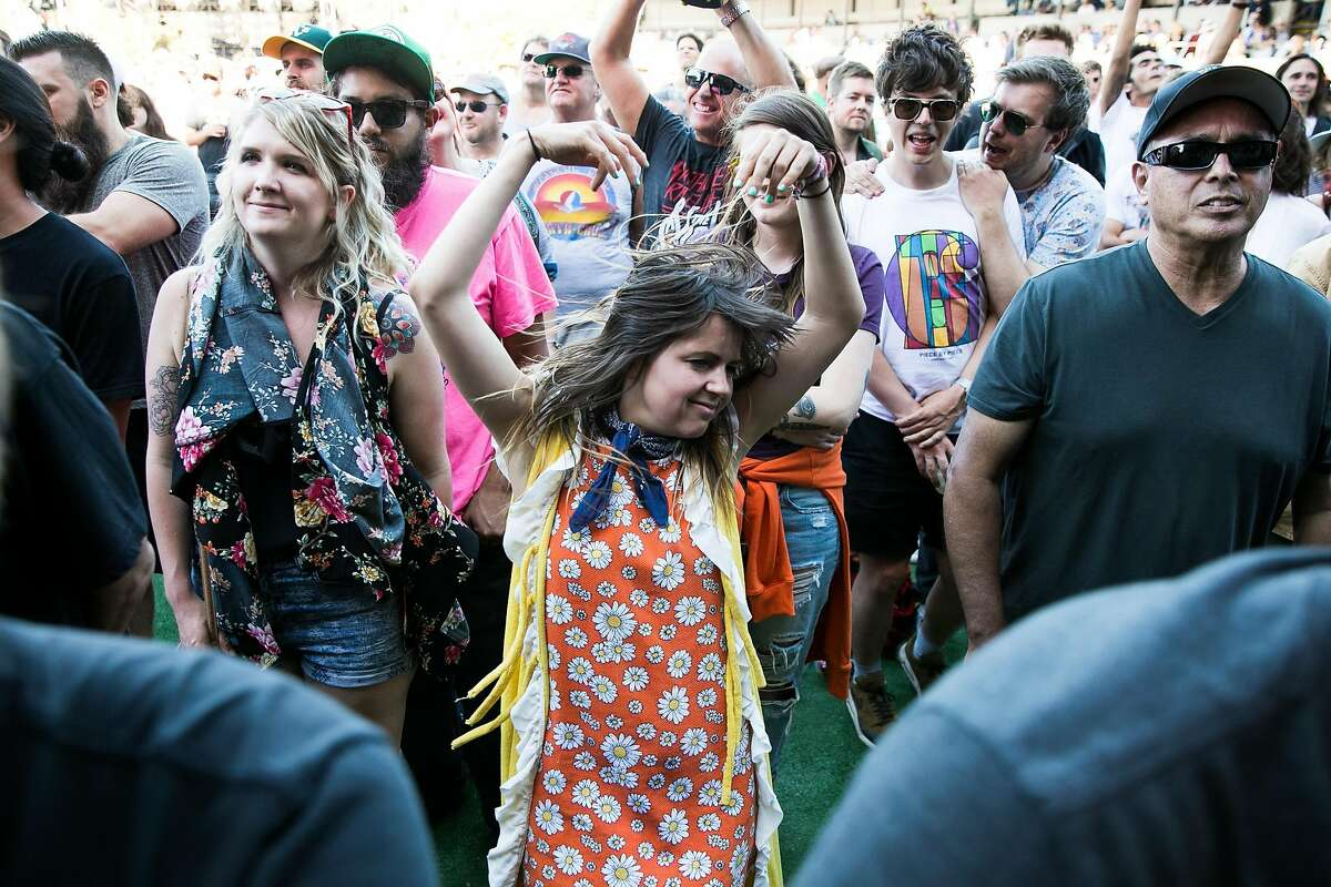 A festival goer dances as Eric Burdon and The Animals perform at the Monterey International Pop Festival at the Monterey County Fairgrounds in Monterey, Calif. Friday, June 16, 2017.