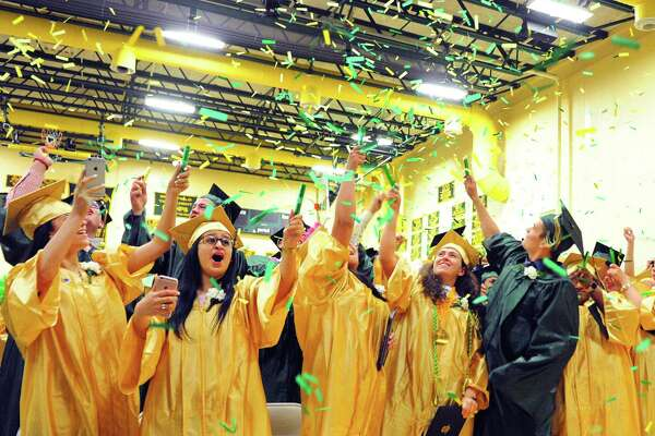 Graduates celebrate with confetti at the conclusion of Emmett O'Brien Technical High School's Class of 2017 Graduation Ceremony in Ansonia, Conn., on Friday June 16, 2017.