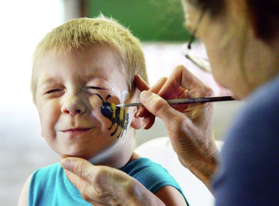 Hunter Warner, 5, of Schenectady gets his face painted during the 5th annual Saratoga Balloon & Craft Festival Friday June 16, 2017 in Ballston Spa, NY.  (John Carl D'Annibale / Times Union) Photo: John Carl D'Annibale / 40040773A
