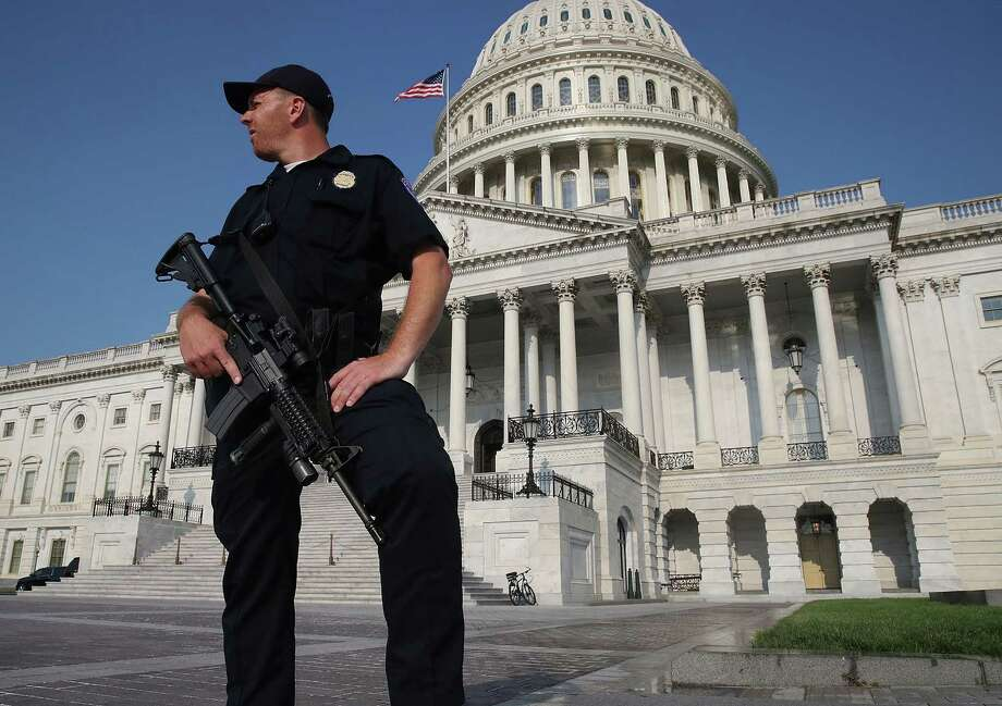 A U.S. Capitol Police officer stands guard in front of the U.S. Capitol Building in Washington last week. Photo: Mark Wilson, Staff / 2017 Getty Images