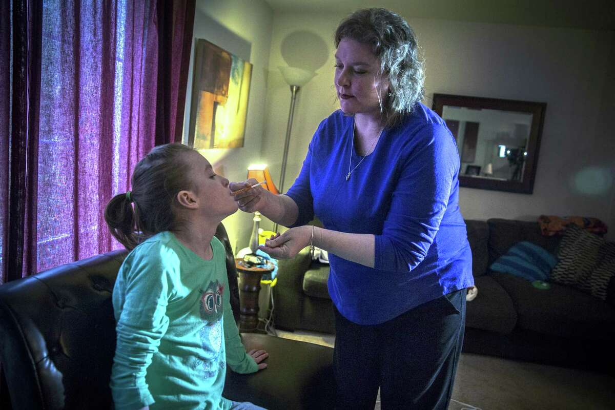 Cara Tarricone gives her daughter, West, one of her two daily doses of cannabis oil at their home in North Windham, Conn. Texas in 2015 approved medical marijuana for patients of intractable epilepsy.