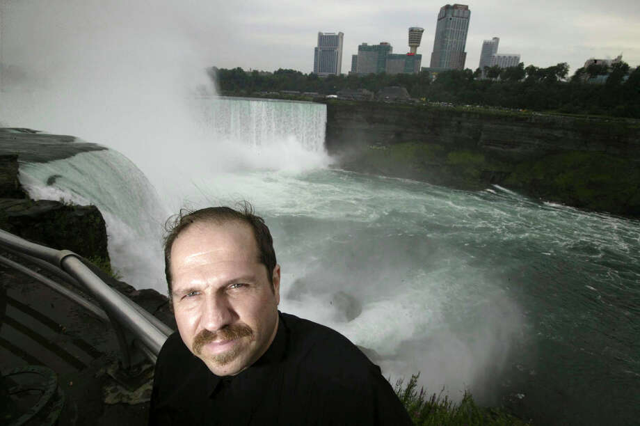 FILE- In this Aug. 13, 2004, file photo, Kirk Jones poses for a photo at Terrapin Point on the American side of Horseshoe Falls in Niagara Falls State Park, N.Y. Jones, who survived a plunge over Niagara Falls without protection in 2003 has died after he went over again, this time inside an inflatable ball. Police told the Syracuse Post-Standard that the body of the 53-year-old was found in the Niagara River by the U.S. Coast Guard on June 2, 2017. (Chip Somodevilla/Detroit Free Press via AP, File) ORG XMIT: MIDTF301 Photo: Chip Somodevilla / Detroit Free Press