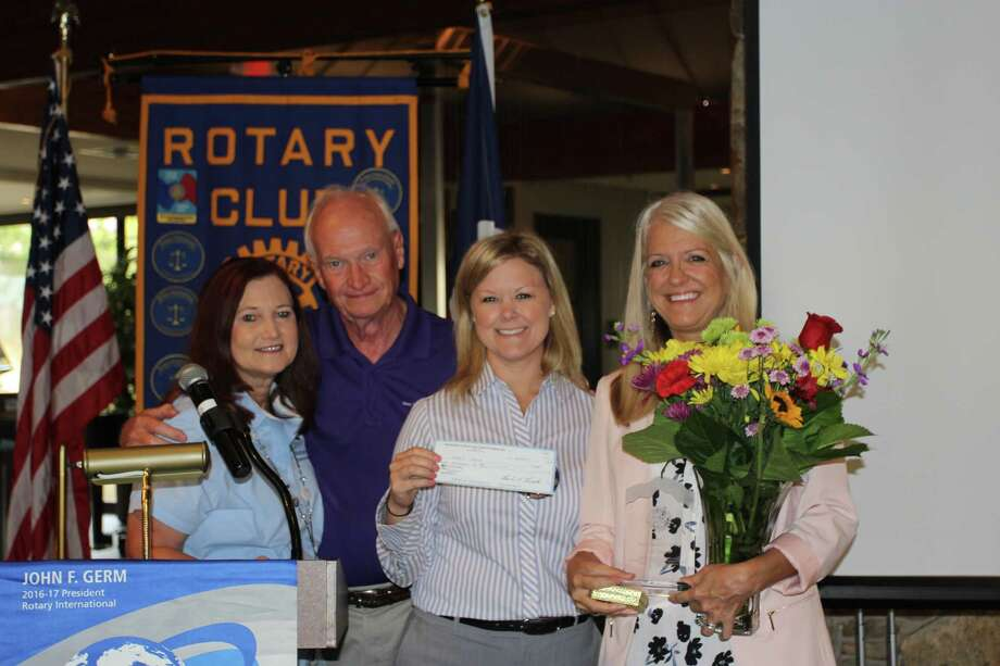 Pictured from left to right are Janet and Gary Milleson, Rotary Club of Lake Conroe President Audrey Blevins, RCLC Non Rotarian of the Year Honoree Terri Jaggers. Jaggers was honored by the club on June 15th for her work with foster children in Texas. Photo: Submitted Photo