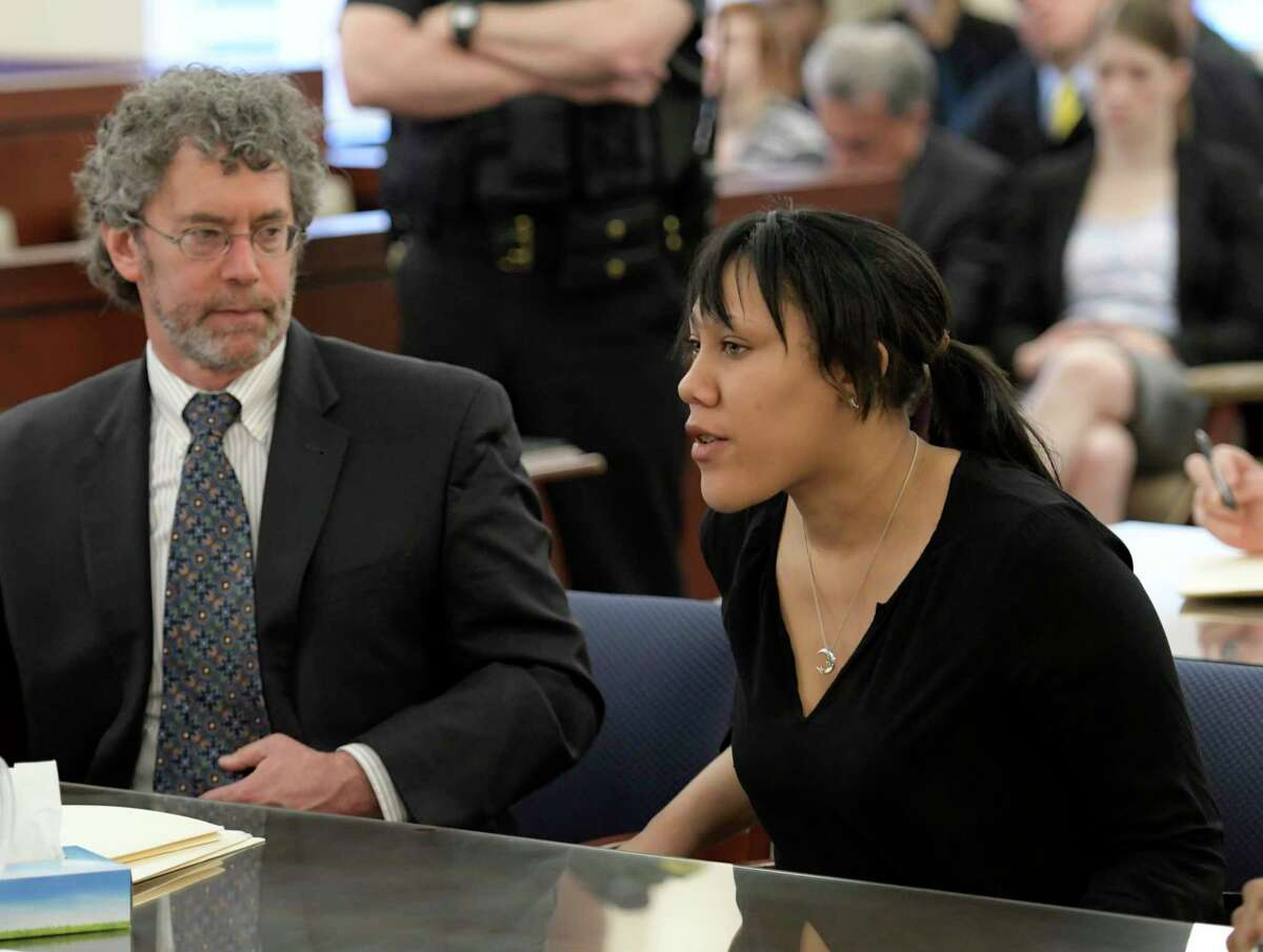 Ariel Agudio, right joined by her attorney Mark Mishler responds to a question from the judge during her sentencing Friday June 16, 2017 in front of Judge Roger McDonough at the Albany County Judicial Center in Albany, N.Y. (Skip Dickstein/Times Union)