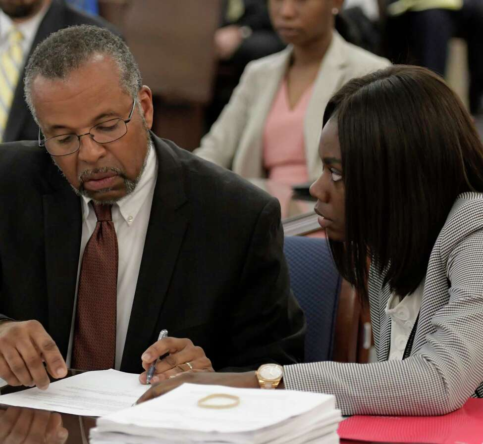 Asha Burwell confers with her attorney Frederick Brewington, left during her sentencing Friday June 16, 2017 in front of Judge Roger McDonough at the Albany County Judicial Center in Albany, N.Y. (Skip Dickstein/Times Union)