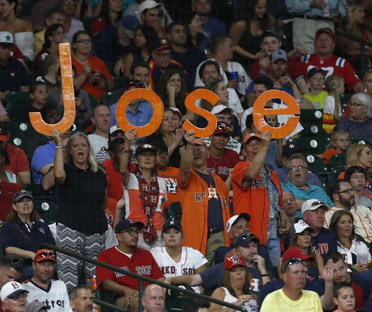 """Houston Astros fans hold up the """"Jose"""" letter as Jose Altuve came up to bat during the fourth inning of an MLB game at Minute Maid Park, Friday, June, 16, 2017. ( Karen Warren / Houston Chronicle )"""