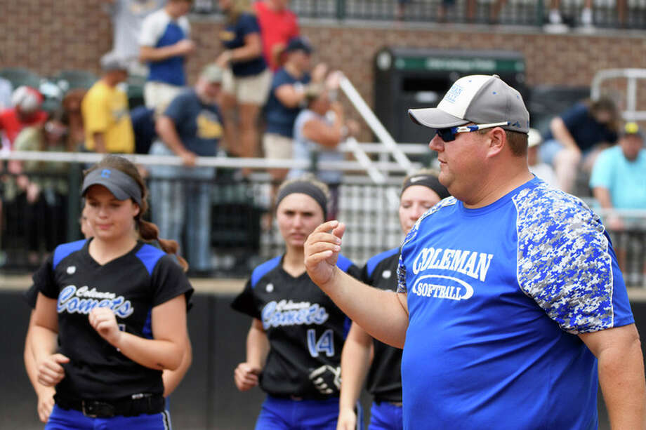 STEVEN SIMPKINS|for the Daily NewsColeman softball coach Chad Klopf gathers his team together for a talk prior to Friday's Division 4 semifinal vs. Ottawa Lake Whiteford on Friday in East Lansing. / Steven Simpkins