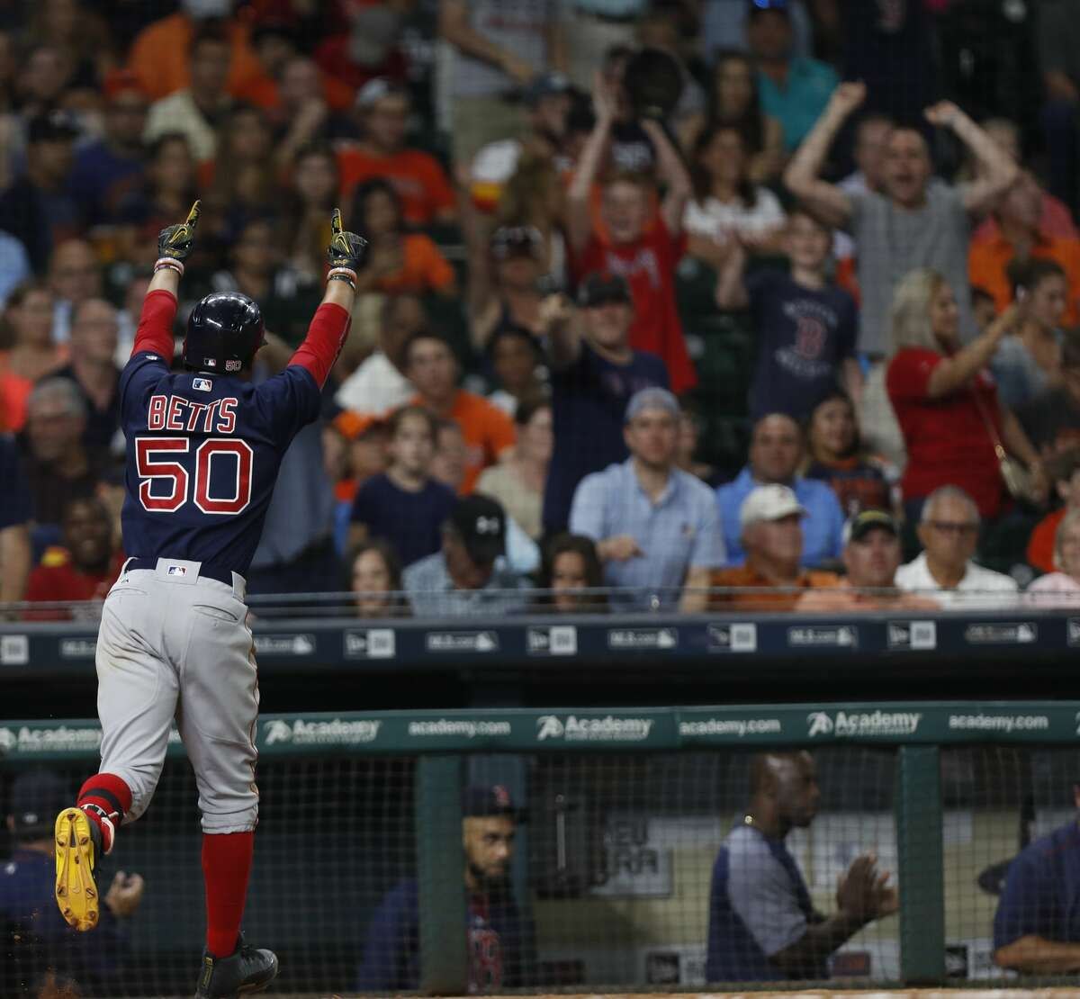 Boston Red Sox Mookie Betts (50) celebrates his home run during the eighth inning of an MLB game at Minute Maid Park, Friday, June, 16, 2017. ( Karen Warren / Houston Chronicle )