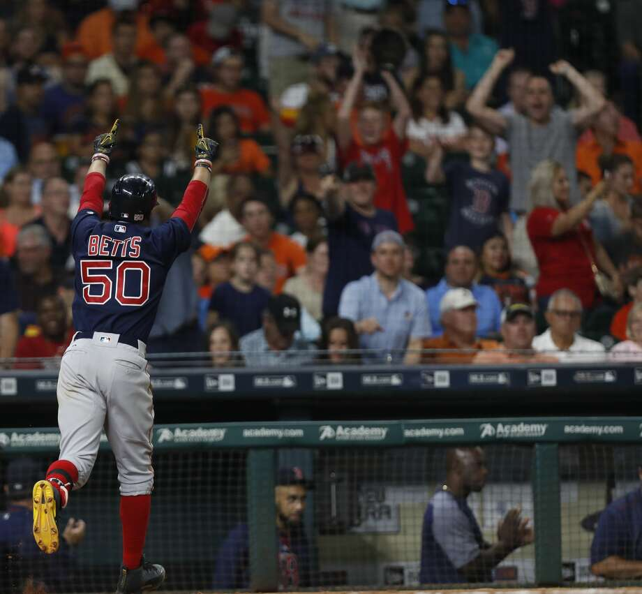 Boston Red Sox Mookie Betts (50) celebrates his home run during the eighth inning of an MLB game at Minute Maid Park, Friday, June, 16, 2017.   ( Karen Warren / Houston Chronicle ) Photo: Karen Warren/Houston Chronicle