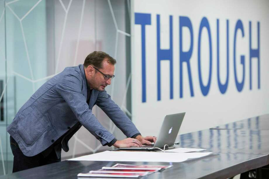 Nate Pagel, of Medifies in San Francisco, works on a presentation during a TMCx accelerator program workshop. Photo: Brett Coomer, Staff / © 2017 Houston Chronicle