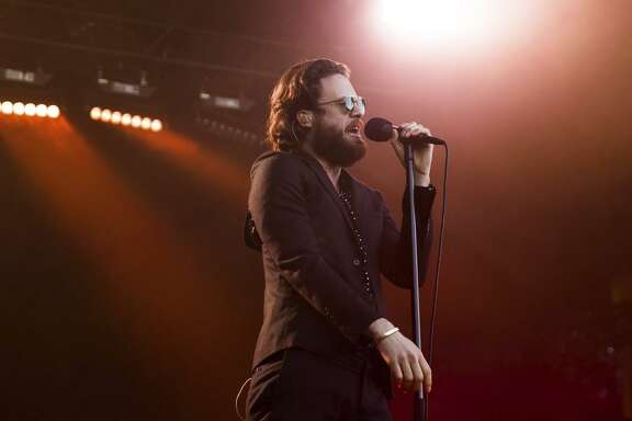 Singer- songwriter Father John Misty per forms on the opening day of the Monterey International Pop Festival. The festival, which runs through Sun day, marks the 50th anniver sary of the first event, which helped usher in the Summer of Love.