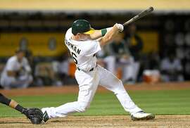 OAKLAND, CA - JUNE 16:  Matt Chapman #26 of the Oakland Athletics hits a bases loaded two-run rbi single against the New York Yankees in the bottom of the eighth inning at Oakland Alameda Coliseum on June 16, 2017 in Oakland, California. The hit was Chapman's first career base hit.  (Photo by Thearon W. Henderson/Getty Images)