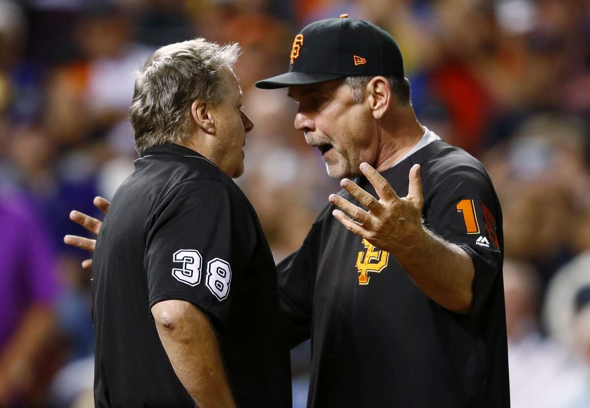 San Francisco Giants manager Bruce Bochy, right, argues with home plate umpire Gary Cederstrom after he ejected Bochy during the seventh inning of the Giants' baseball game against the Colorado Rockies on Friday, June 16, 2017, in Denver. The Rockies won 10-8. (AP Photo/David Zalubowski)