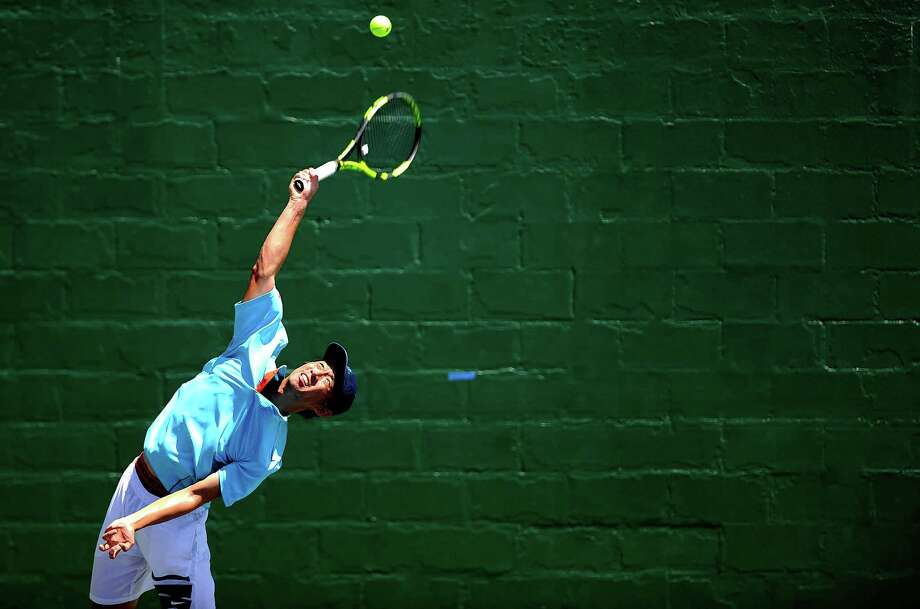 Kevin Zhu of Pearland serves against Pranav Kumar in the finals of the USTA Texas Grand Slam boys' singles final Saturday in Abilene. Kumar outlasted Zhu, 6-3, 2-6, 6-1 in the championship match. Photo: Thomas Metthe