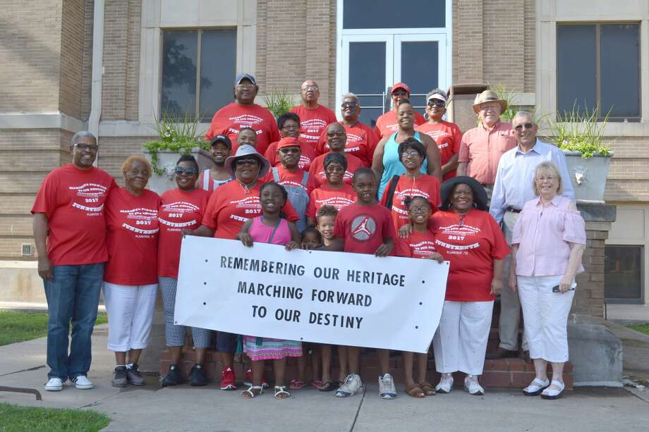 "Participants in Saturday morning's march celebrating Juneteenth in Plainview gather on the courthouse steps prior to parading north along Broadway. The weekend celebration remembers the formal announcement on June 19, 1865, in Galveston, that the Civil War had finally ended and all slaves in Texas and throughout the United States were free. This year's theme is ""Remembering our heritage, marching forward to our destiny."""