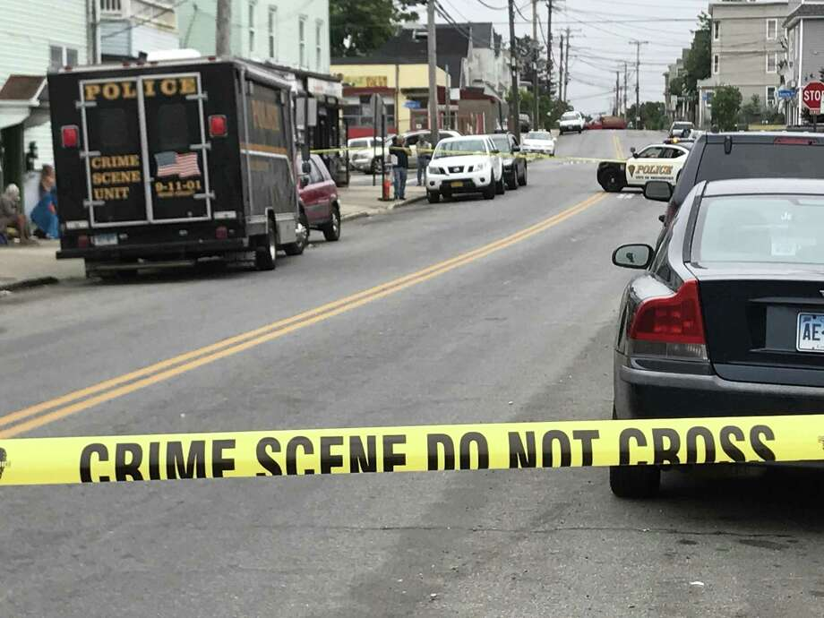 """Police blocked off a section of Pequonnock Street in Bridgeport on Saturday morning to investigate what they called a """"suspicious"""" death. Photo: Cathy Zuraw /Hearst Connecticut Media"""