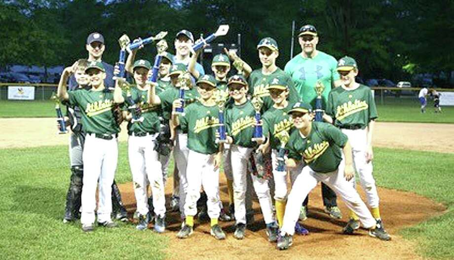 The Wilton Little League Athletic A's Majors baseball team sponsored by Bankwell took home the championship against the Braves 10-8. Players include, from left, Chris McCann, George Hahn, Jonathan Yerrall, William McCormack, Jake Enman, Andrew Ryan, Ryan Preisano, James Ring, Ian Seelert, Zachary Krawitz, Max Scolnik, and James Doylem, and coaches Bob Ryan and Keith McCormack and Head Coach Anthony Preisano. Photo: Contributed Photo / Hearst Connecticut Media / Norwalk Hour