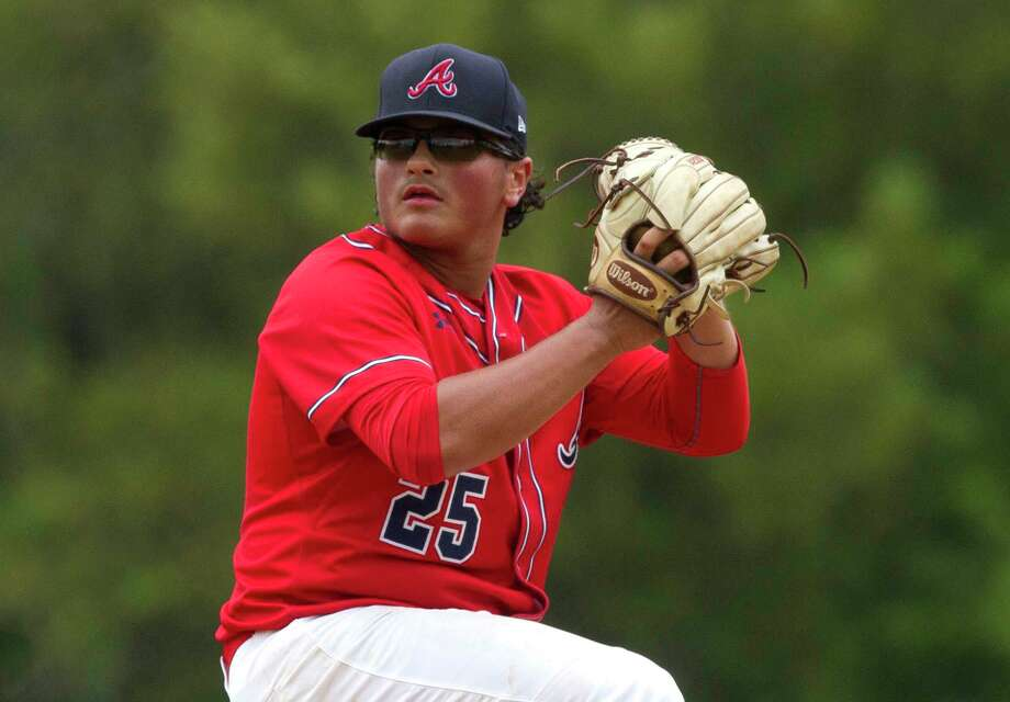 Atascocita pitcher Alden Blest (25) throws as rain falls during the second inning of a high school baseball game at the Wings-N-More Classic Thursday, March 9, 2017, in The Woodlands. The Woodlands defeated Atascocita 2-0. Photo: Jason Fochtman, Staff Photographer / © 2017 Houston Chronicle