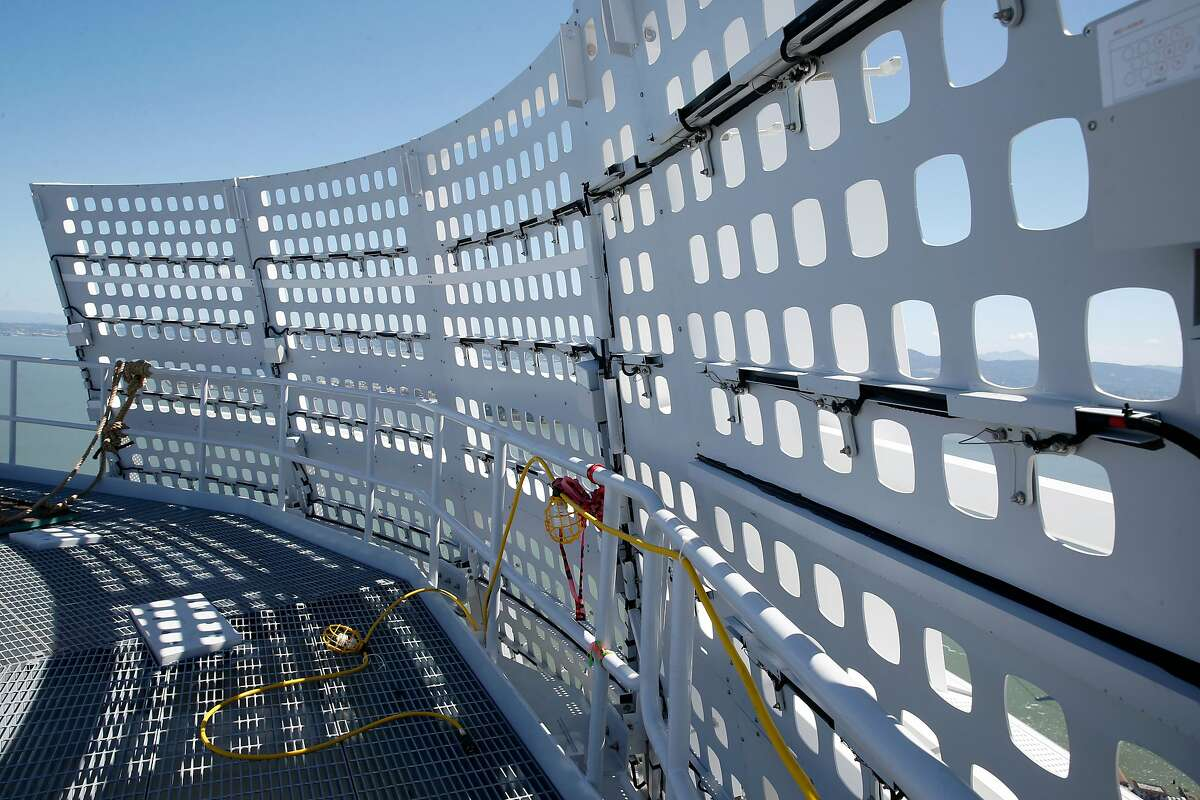 Construction workers install large panels featuring a total of 11,000 LEDs around the crown of the 1,070-foot Salesforce Tower for artist Jim Campbell's light installation in San Francisco, Calif. on Friday, May 12, 2017.