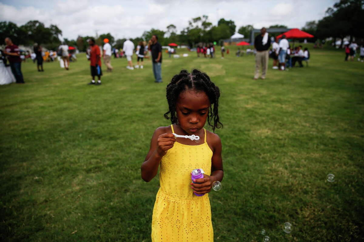 Larryn Block, 5, blows bubbles before the rededication ceremony for Emancipation Park Saturday, June 17, 2017 in Houston after a $33 million renovation to the park in the Third Ward.