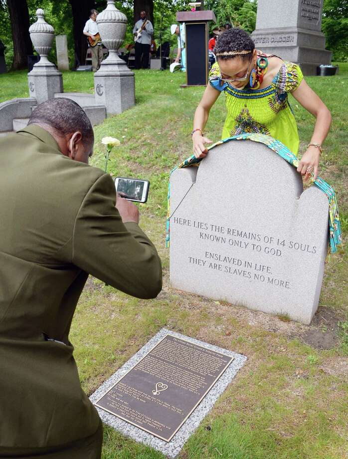Jeffrey Melton, left, and Gwendolyn Hayles, both of Albany,  at the bronze plaque and grave marker during a dedication ceremony marking the Historic African Burial Ground site at St. Agnes Cemetery Saturday June 17, 2017 in Menands, NY.  (John Carl D'Annibale / Times Union) Photo: John Carl D'Annibale / 20040589A