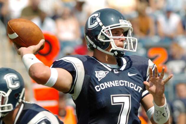 UConn quarterback Dan Orlovsky delivers a pass during the season opening game against Murray State at Rentschler Field in East Hartford on Sept. 4, 2004.