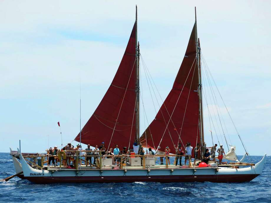 FILE - In this April 29, 2014 file photo, the Hokulea sailing canoe is seen off Honolulu. The Polynesian voyaging canoe is returning to Hawaii after a three-year journey around the world guided only by nature with navigators using no modern navigation to guide Hokulea across 40,000 nautical miles to 19 countries. Thousands are expected to welcome the double-hulled canoe to Oahu, Hawaii, on Saturday, June 17, 2017. (AP Photo/Sam Eifling, File) Photo: Sam Eifling, STF / Copyright 2017 The Associated Press. All rights reserved.