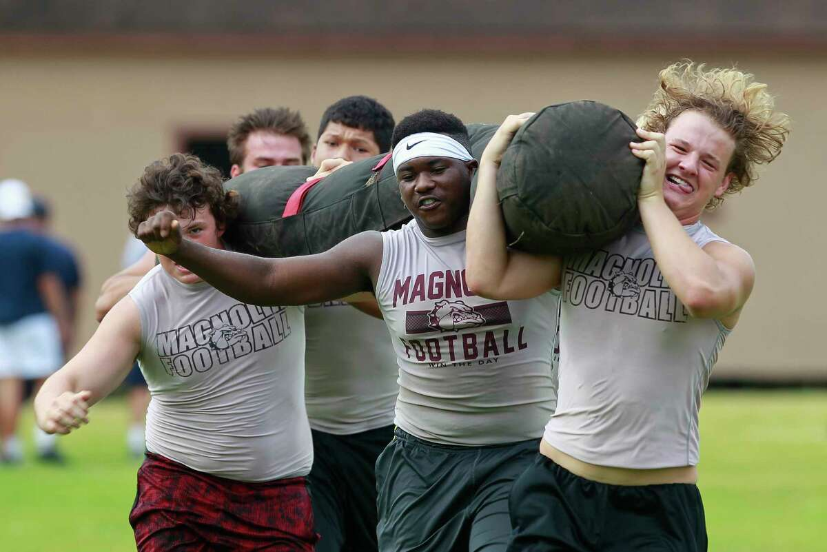 Magnolia competes in the worm carry during the annual War Zone Lineman Challenge at Oak Ridge High School, Saturday, June 17, 2017.