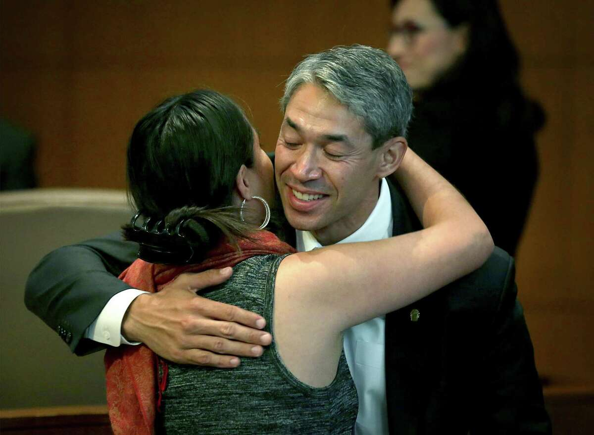 Nirenberg is greeted by a supporter after attending his last council meeting as a councilman.