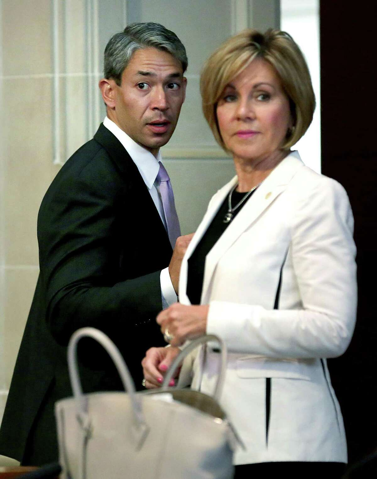 Mayor elect Ron Nirenberg, left, chats with City Manager Sheryl Sculley at the end of his last council meeting as a councilman, in the Municipal Complex on Thursday June 15, 2017.