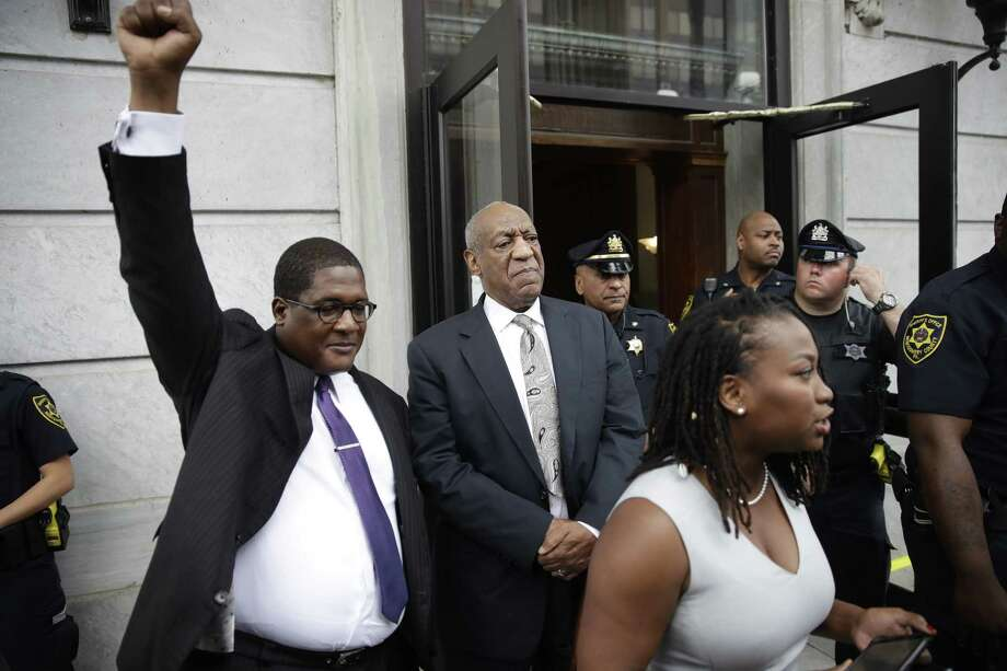 Andrew Wyatt raises his fist as Bill Cosby exits the Montgomery County Courthouse after a mistrial was declared in Norristown, Pa., Saturday, June 17, 2017.   Cosby's trial ended without a verdict after jurors failed to reach a unanimous decision. (AP Photo/Matt Rourke) Photo: Matt Rourke, STF / Copyright 2017 The Associated Press. All rights reserved.
