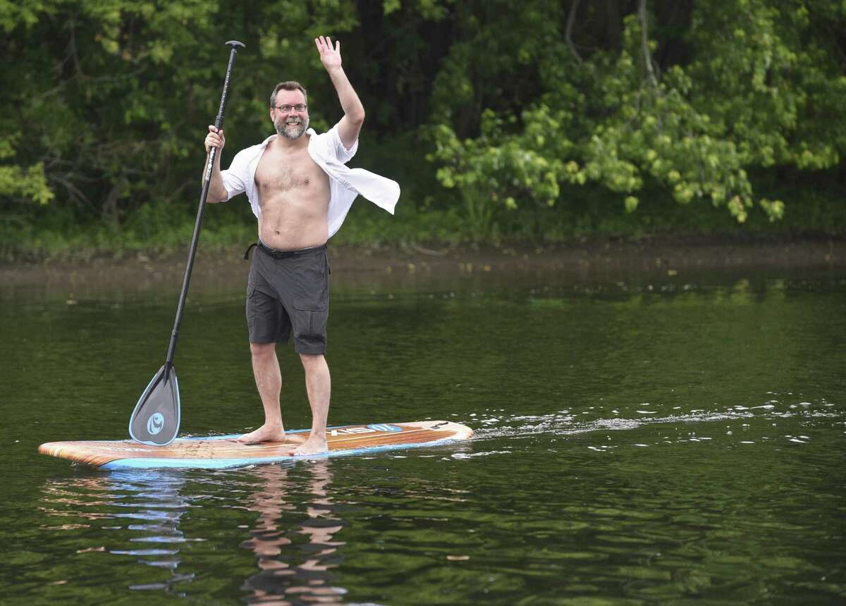 New Milford Mayor David Gronbach led a flotilla of boats down the Housatonic River to the New Milford River Trail Association's opening celebration for New Milford's river walk on Saturday, June 17, 2017, in New Milford, Conn.