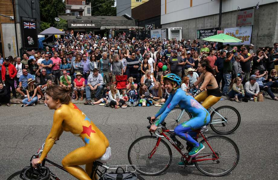 Naked bicyclists ride the parade route. Photo: GENNA MARTIN
