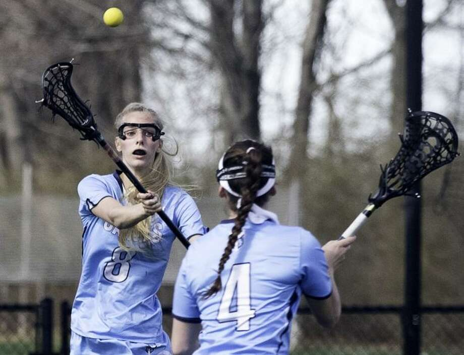 Two-time All-America lacrosse player Sara Bouwman of New Fairfield, left, in action for Canterbury this past season. Photo: Contributed Photo / Contributed Photo / Marc Vanasse