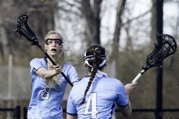 Two-time All-America lacrosse player Sara Bouwman of New Fairfield, left, in action for Canterbury this past season.