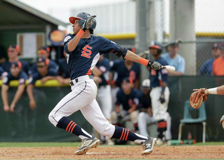 Seven Lakes Spartans outfielder Lamar Sparks (14) triples in the seventh inning of  the second game of the UIL 2016 High School Baseball State Championship Second Round Playoff game between the Cypress Ranch Mustangs and the Seven Lakes Spartans at Seven Lakes High School on Saturday, May 14, 2016. Photo: Tim Warner, Freelance / Houston Chronicle