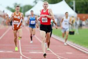 New Braunfels Canyon's Sam Worley looks to the stadium scoreboard after crossing the finish line of the Jerry Thompson Invitational Mile Run during the 2017 Texas Relays at Mike A. Myers Stadium in Austin on Saturday, April 1, 2017. Worley took the lead on the final lap to win the event with a time of 4:00.61. (File photo)